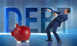 The businessman pulling piggybank with rope Stock Image