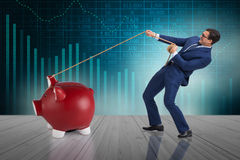 The businessman pulling piggybank with rope Royalty Free Stock Photo