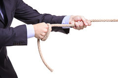 Businessman pulling a rope. Isolated on white background Stock Photo