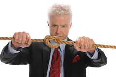 Businessman pulling a rope Stock Photography