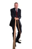 Businessman pulling rope. Royalty Free Stock Photos