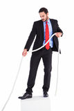 Businessman pulling a rope with effort Royalty Free Stock Photos