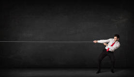 Businessman pulling rope on grey background. Concept Royalty Free Stock Images