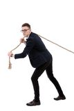 Businessman pulling a rope Stock Image