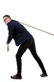 Businessman pulling a rope Royalty Free Stock Photos