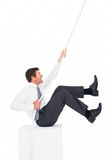 Businessman pulling a rope. On white background Royalty Free Stock Photos