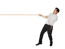 Businessman Pulling Rope. Young Asian male pulling rope isolated on white Royalty Free Stock Photography
