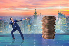 The businessman pulling stack of gold coins Stock Photo