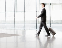 A businessman pulling suitcase along Stock Photo