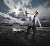 Businessman pulling suitcase with money Royalty Free Stock Photo