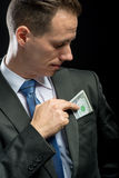 Businessman pulling their money out Stock Photos
