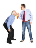 Businessman pulling a tie to older man Royalty Free Stock Images