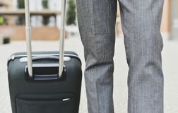 Businessman pulling a trolley case Royalty Free Stock Photography