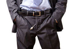 Businessman pulling a usb cable off his pants. Royalty Free Stock Photography