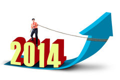 Businessman pulls the new year 2014 Stock Photos