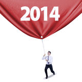 Businessman pulls new year banner Stock Photography