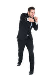 Businessman Punching Over White Background Royalty Free Stock Photos