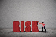 Businessman hit risk Stock Photo