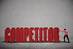 Businessman hit competitor Royalty Free Stock Image