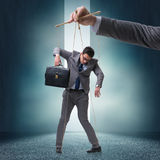 The businessman puppet being manipulated by boss Royalty Free Stock Image