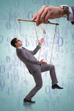 The businessman puppet being manipulated by boss stock image