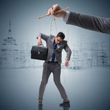 The businessman puppet being manipulated by boss Stock Photos