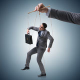 The businessman puppet being manipulated by boss stock images