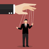 Businessman puppet on ropes Stock Image