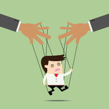 Businessman puppet on ropes. Stock Photo