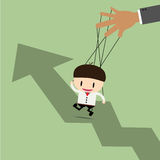 Businessman puppet on ropes and graph up. Royalty Free Stock Photos
