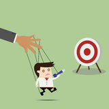 Businessman puppet on ropes to target. Stock Images