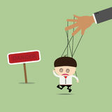 Businessman puppet on ropes in what sounds. Business manipulate. Behind the scene concept Stock Photos