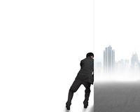 Businessman push away cityscape wall Stock Photo