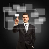 Businessman push the button. On virtual touch pad Stock Image