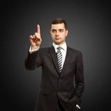 Businessman push the button. On virtual touch pad Royalty Free Stock Images