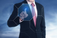 Businessman push button the screen. The inovation of technology success concept royalty free stock photos