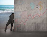 Businessman push doodles concrete wall away. With beach Royalty Free Stock Images