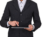 Businessman push finger on tablet Royalty Free Stock Images