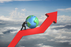 Businessman push globe upward on red trend line. With cumulus cloudscape background royalty free stock images