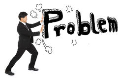 Businessman push problem texture out away from his Stock Photography