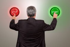 Businessman push start or stop Stock Images