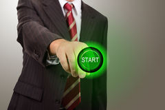 Businessman push start Stock Images