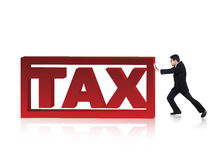 Businessman push a tax sign. Businessman try to push a tax sign Stock Photos