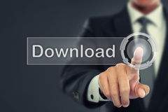 Businessman push to  Download button on virtual screen Royalty Free Stock Photo