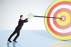 Businessman pushes arrow exactly in bull's-eye concept Royalty Free Stock Image