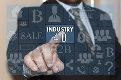 Businessman pushes a button INDUSTRY 4.0 on the touch screen wit. H metro style graphic user interface Royalty Free Stock Photography