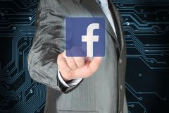 Businessman pushes Facebook icon royalty free stock images