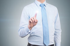 Businessman pushes invisible button Royalty Free Stock Photo