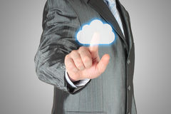 Businessman pushes virtual cloud button Stock Images