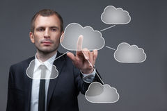 Businessman pushes virtual cloud button Stock Photography